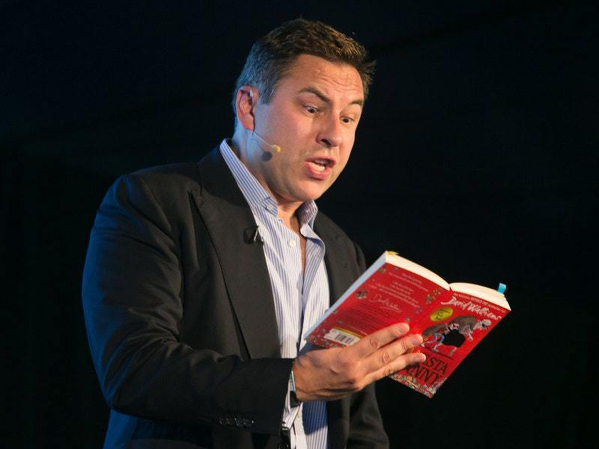 David Walliams reads one of his books to the attendees at Radio Times Festival