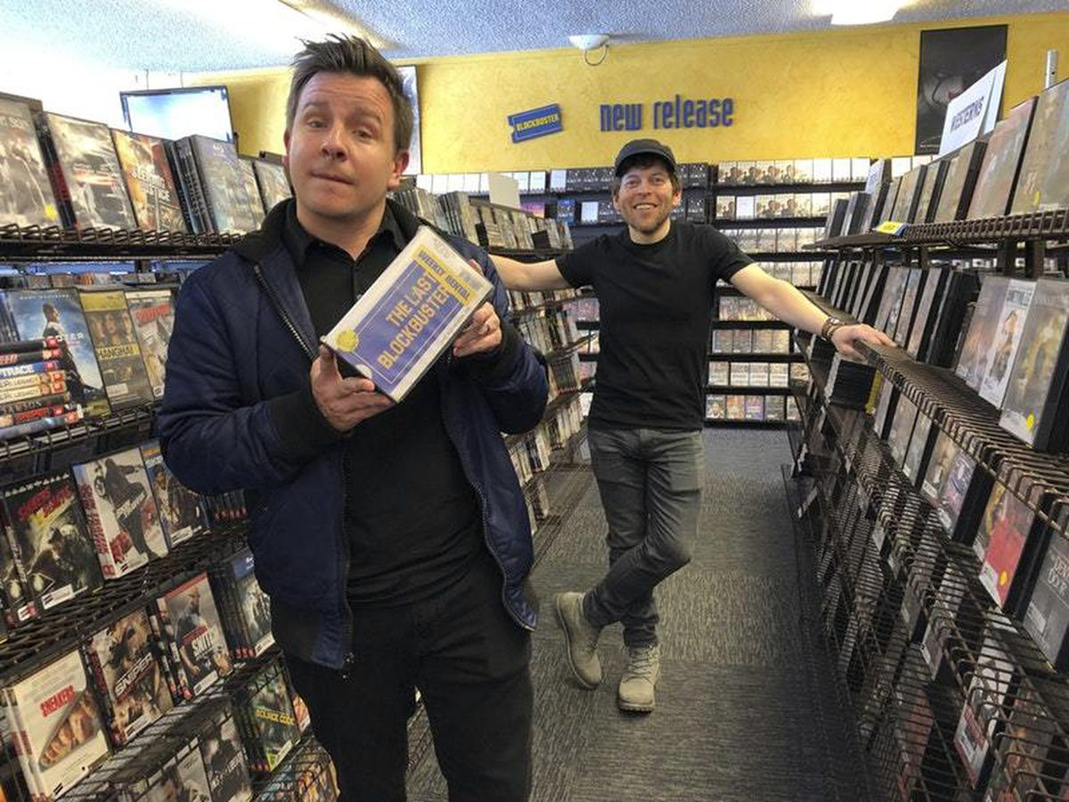 Documentary filmmakers Taylor Morden and Zeke Kamm pose at the last Blockbuster on the planet