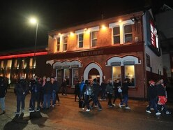Italian men charged over Anfield attack on Liverpool supporter