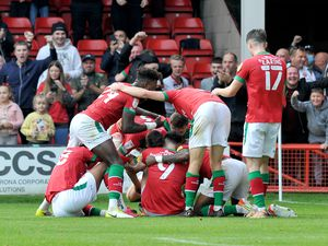 SPORT COPYRIGHT MNA MEDIA TIM THURSFIELD 09/10/21 .WALSALL V SALFORD CITY.Players mob Conor Wilkinson after he scores the winner....
