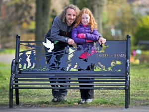 Park volunteers Graeme Forbes and daughter Maddie, aged seven, with one of the new WWII benches