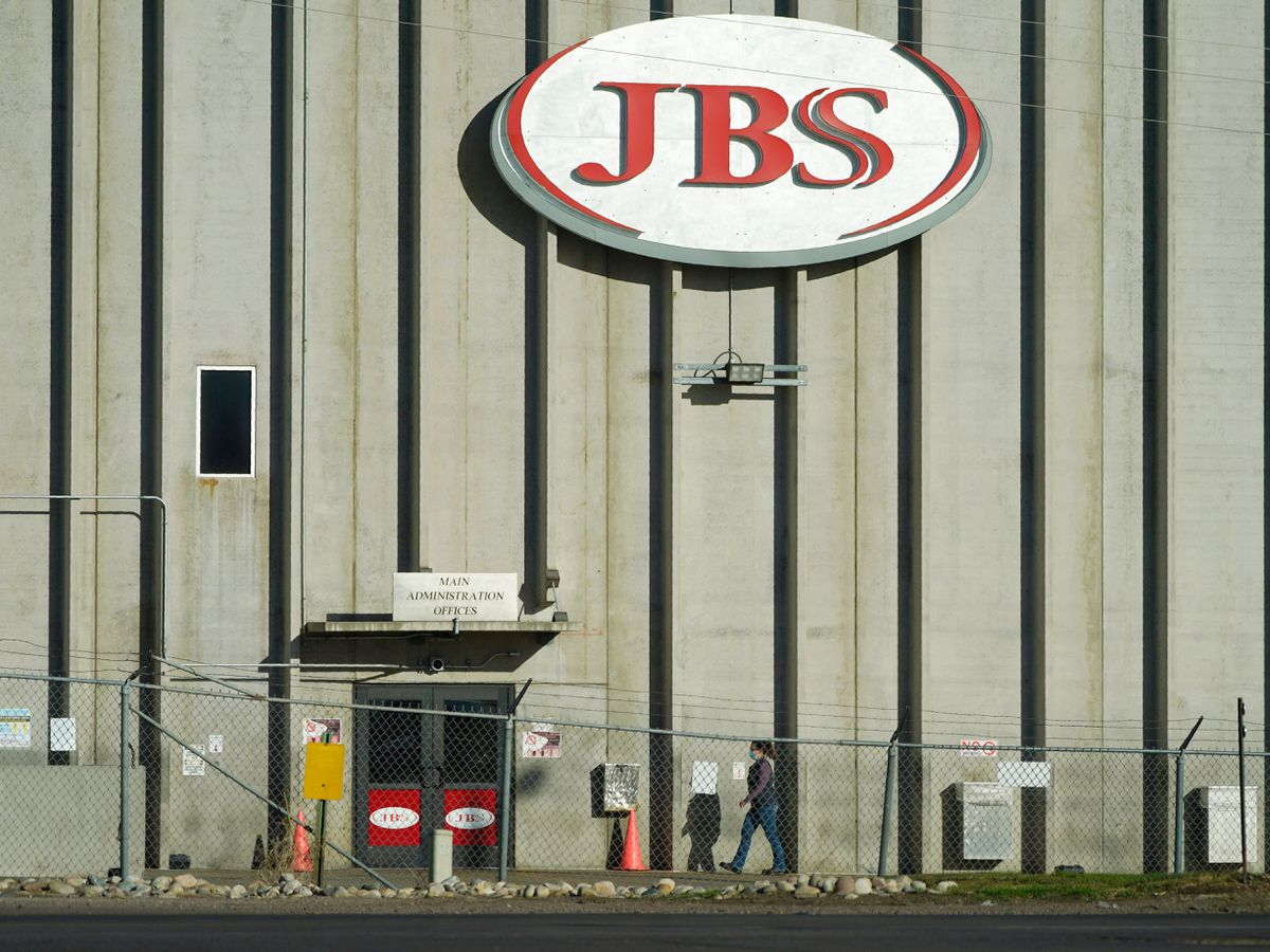 A worker heads into the JBS meatpacking plant in Greeley, Colorado