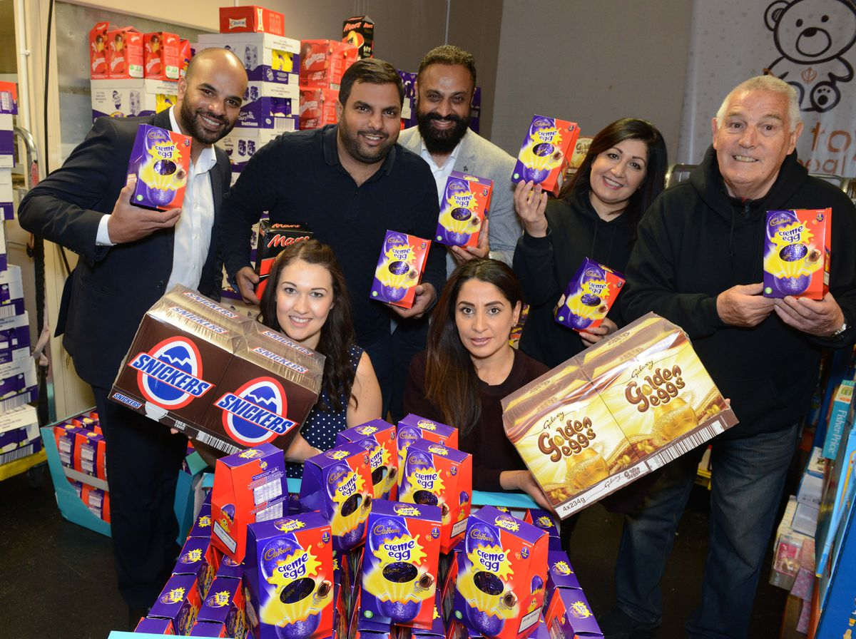 Pictured front, L-R: Lucy Russon and Sonia Dwaliwal along with staff and volunteers at the Sikh Toy Appeal, Moorfield Works Upper Villiers Street, Wolverhampton, as they take dilivery of over a thousand Easter eggs