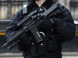 Cash and cannabis seized but no arrests as armed police raid Cannock house