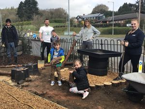 Bill Bell, Dave Manser and son Oscar, teacher Vicki Harrison and Chloe Smout, assistant manager at TG Hardwicks, with pupils Oliver and Lexi Clegg
