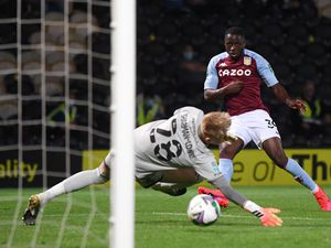 """Aston Villa's Keinan Davis (right) scores his side's third goal of the game during the Carabao Cup match at the Pirelli Stadium, Burton. PA Photo. Picture date: Tuesday September 15, 2020. See PA story SOCCER Burton. Photo credit should read: Laurence Griffiths/NMC Pool/PA Wire. EDITORIAL USE ONLY No use with unauthorised audio, video, data, fixture lists, club/league logos or """"live"""" services. Online in-match use limited to 120 images, no video emulation. No use in betting, games or single club/league/player publications."""