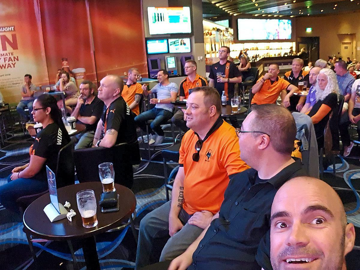 Western Australia Wolves supporters with a beaming Luke Clarke