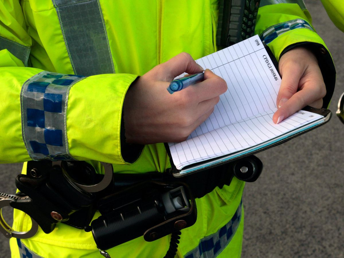 A police officer taking notes