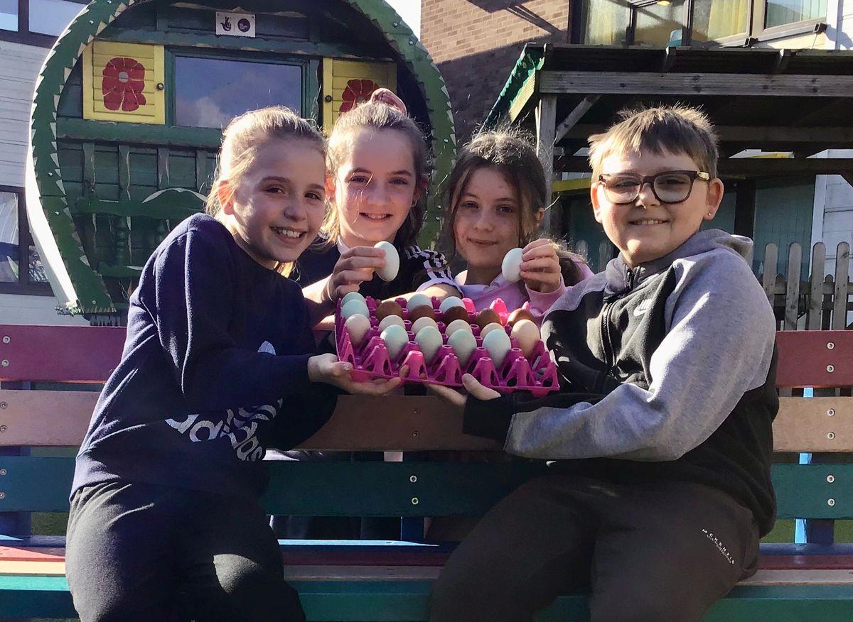 St Bart's pupils Lacey Norton, Thomas Webb, Portia Sutcliffe and Gracie Malinowski with the eggs