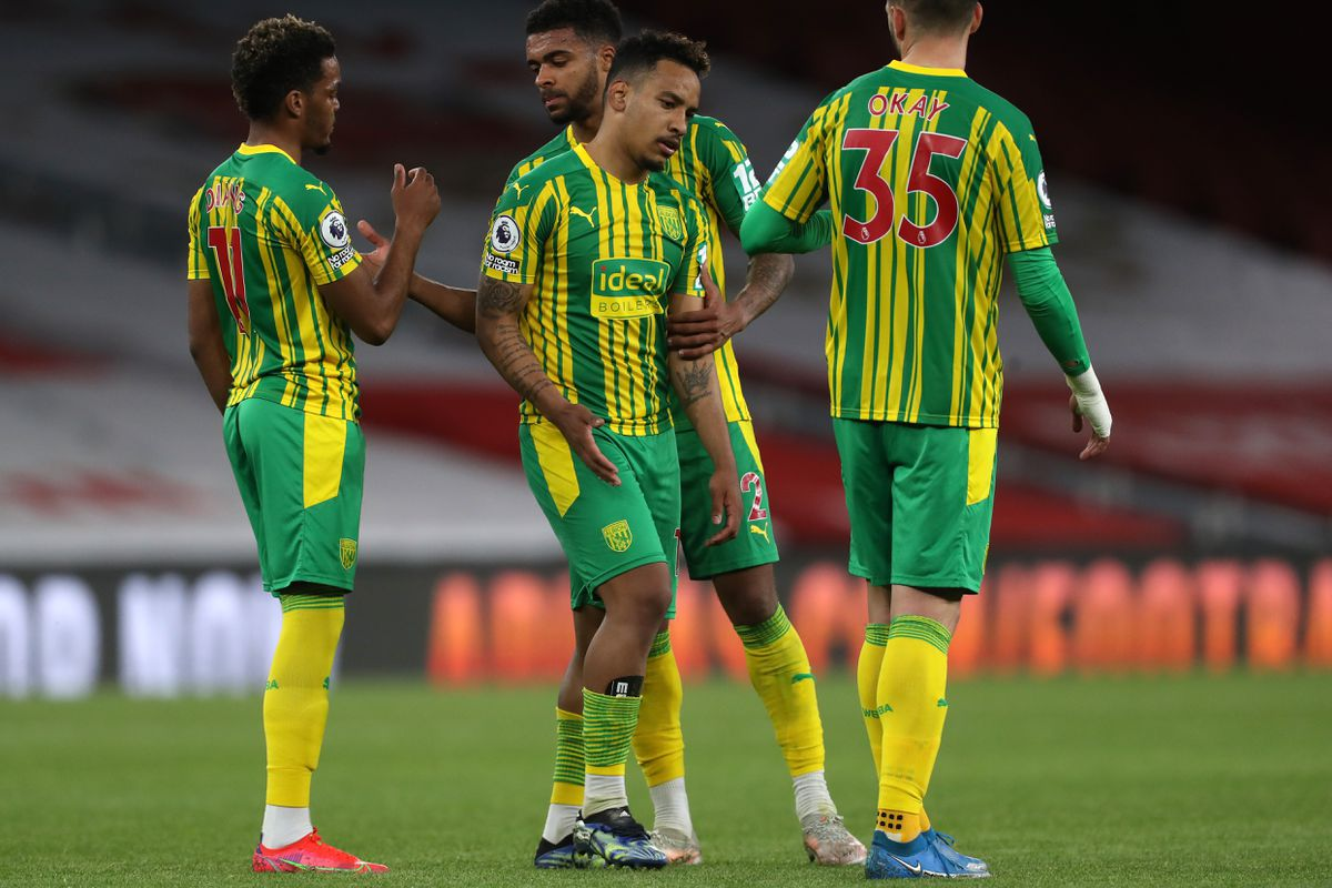 Matheus Pereira of West Bromwich Albion is consoled by Grady Diangana of West Bromwich Albion, Darnell Furlong of West Bromwich Albion and Okay Yokuslu of West Bromwich Albion as he reacts at the final whistle having lost 3-1 meaning that West Bromwich Albion are relegated from the Premier League.