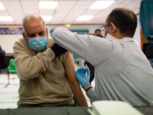 Masud Ahmad, 79, receives an injection of the Oxford/AstraZeneca coronavirus vaccine