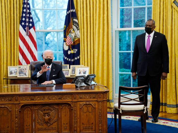 President Joe Biden meets with secretary of defence Lloyd Austin