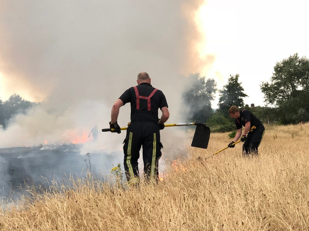 watch two grass fires tackled amid sweltering weather. Black Bedroom Furniture Sets. Home Design Ideas