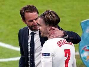 England manager Gareth Southgate speaks to Jack Grealish as he prepares to bring him on during the UEFA Euro 2020 semi final match at Wembley Stadium, London. Picture date: Wednesday July 7, 2021. PA Photo. See PA story SOCCER England. Photo credit should read: Mike Egerton/PA Wire.    RESTRICTIONS:  Use subject to restrictions. Editorial use only, no commercial use without prior consent from rights holder.