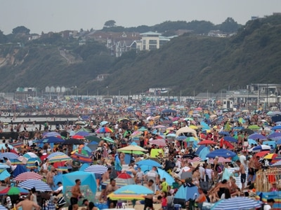 Sunseekers told to stay away from packed beaches amid UK heatwave