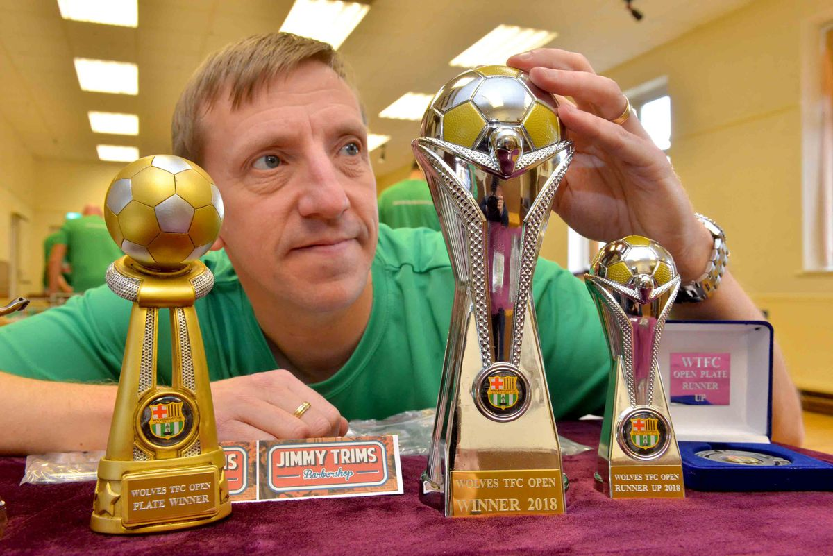 Chairman Justin Scott with some of the club's trophies