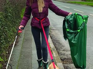 Hollie Barlow and Rufus on a litterpicking mission in Doxey.