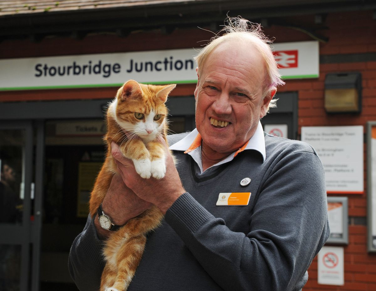 DUDLEY PIC  /  DAVID HAMILTON PIC / EXPRESS AND PIC 5/9/20 Station supervisor Ian Tomlinson, who has worked for 50 years on the railways, at Stourbridge Junction, Stourbridge, with George the station cat..