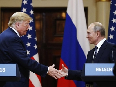 Trump backs off siding with Russia over US intelligence amid bipartisan anger