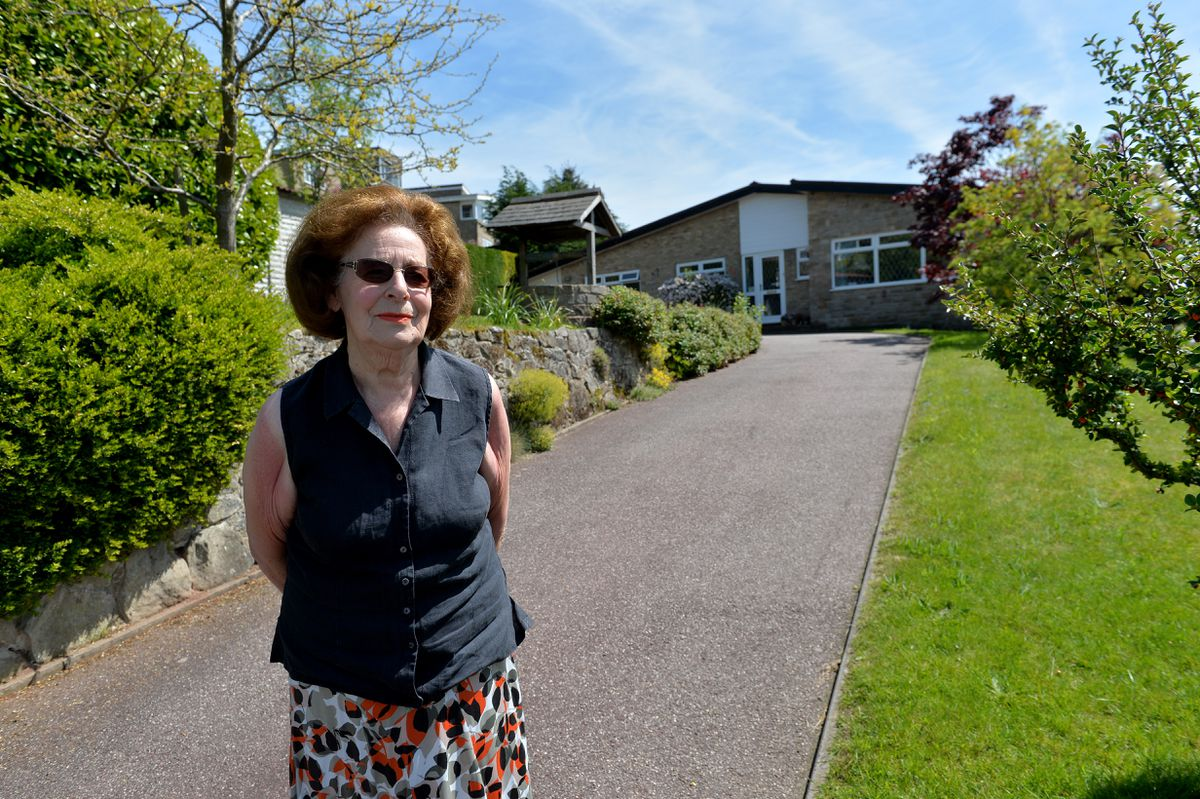 Councillor June Brown-Bullivant in front of her Hopton home