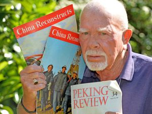 Retired seaman Tom Cartwright from Hednesford, with the propaganda he was given during a visit to China in 1971