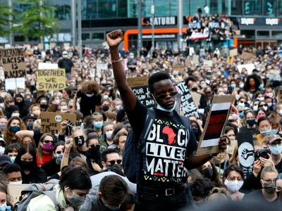 Protesters support Black Lives Matter on three continents