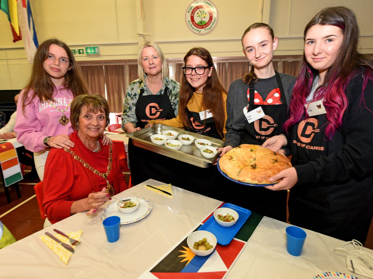 Lakis Greek Kitchen ( LGK) a registered charity in Walsall are working in partnership with Walsall Council to deliver a series of programmes for Walsall families. Pictured is Walsall mayor Rose Burley, with granddaughter mayoress Jade Micallef, organiser Jennie Dalton, and some of the children who have cooked the food..
