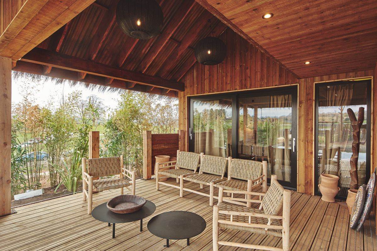The balcony with outdoor seating at one of the elephant lodges at West Midland Safari Park