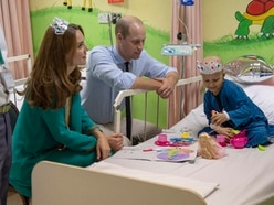 Kate wears toy tiara for girl's tea party during visit to cancer hospital