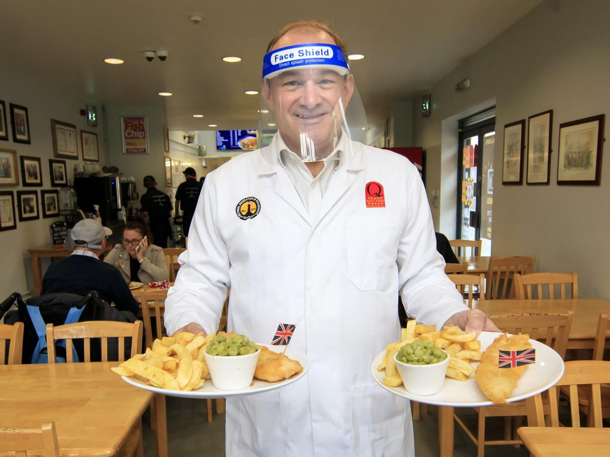 Sir Ed Davey puts in a shift at Taylors fish and chip shop in Stockport