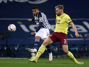 Karlan Grant of West Bromwich Albion and Charlie Taylor of Burnley. (AMA)