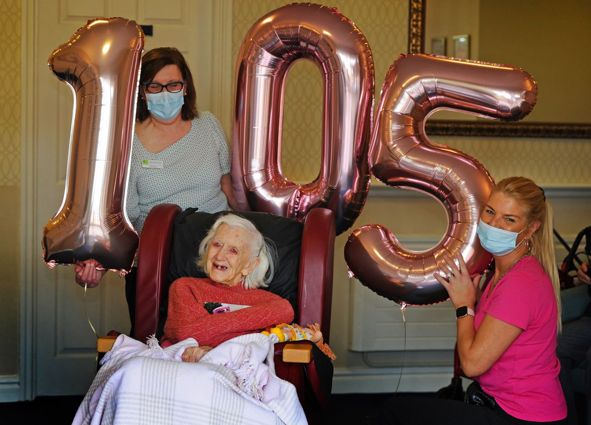 Celebrating her 105th birthday, Eileen Summerton with manager Jayne Lilley, left, and activities co-ordinator Louise Page
