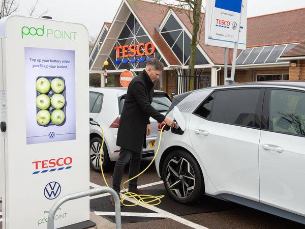 Electric VW ID3 car charging outside of Tesco