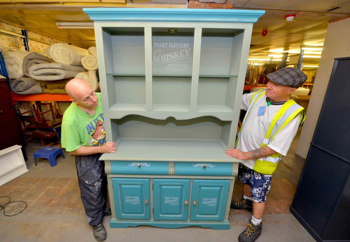 Dave Barden from Tividale, and Paul Jesson from Smethwick, with some furniture that have refurbished..