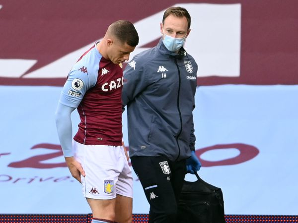 "Aston Villa's Ross Barkley sits injured prior to being substituted during the Premier League match at Villa Park, Birmingham. PA Photo. Picture date: Saturday November 21, 2020. See PA story SOCCER Villa. Photo credit should read: Laurence Griffiths/PA Wire.    RESTRICTIONS: EDITORIAL USE ONLY No use  with unauthorised audio, video, data, fixture lists, club/league logos or ""live"" services. Online in-match use limited to 120 images, no video emulation. No use in betting, games or single club/league/player publications."