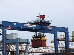 A cargo crate being moved in Belfast Port,