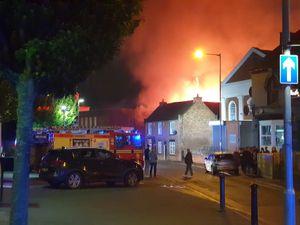 The blaze turned the sky orange in the surrounding area. Photo: Jonathan Smith