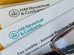 Tax office worker accused of pocketing almost £19k in scam