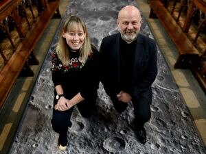 WOLVERHAMPTON NEWS EXPRESS & STAR ( JOHN SAMBROOKS)  03/03/2020..The Reverend David Wright and Curate Abbie Walsh with the Moon surface artwork at St Peter's Church in Wolverhampton.............................................................................................................................................................................................................................................................................  .............................