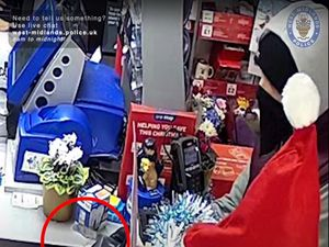 CCTV footage shows Karl Jarvis, from Walsall, holding a knife at a One Stop shop