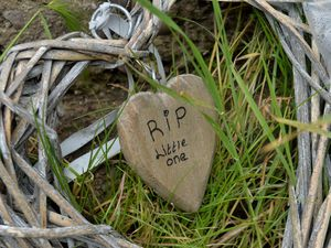 Tributes remain next to the Wyrley and Essington Canal where the baby boy was found