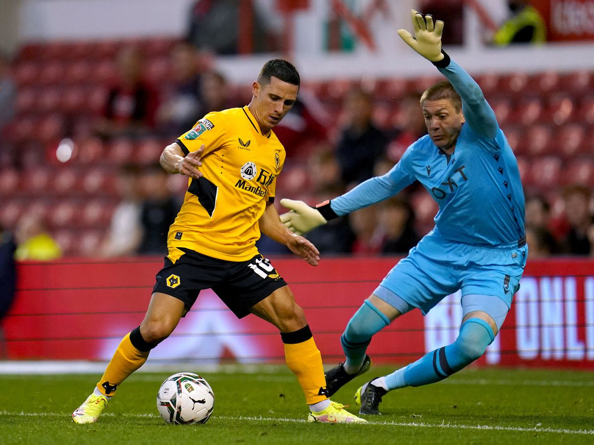 Nottingham Forest goalkeeper Ethan Horvath (right) and Wolverhampton Wanderers' Daniel Podence