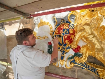 Queen's local church in Edinburgh back to its best as coat of arms restored