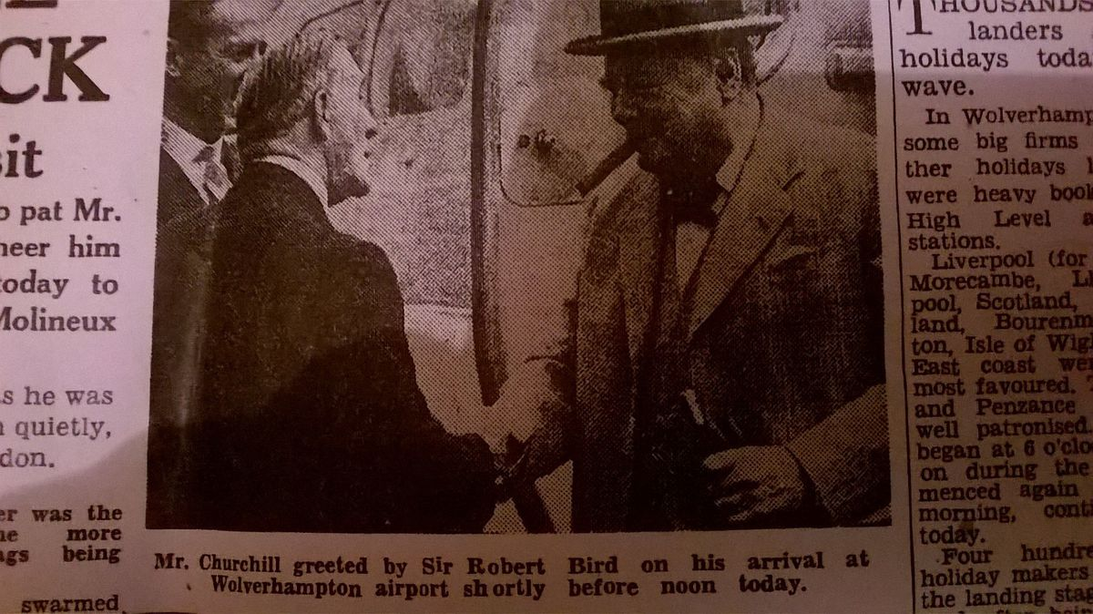 Churchill is greeted by Sir Robert Bird as he stepped out of the plane