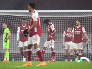Arsenal's Mohamed Elneny (centre) and team-mates appear dejected