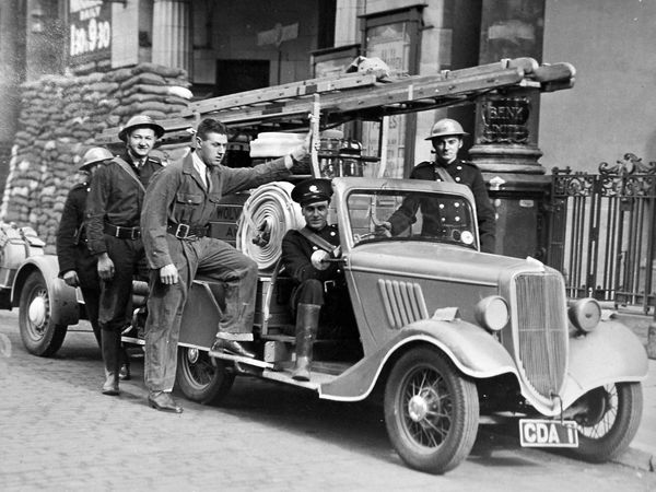 """First on the scene of a """"fire"""" at the Queen's Picture House in Wolverhampton in October 1939 was this crew – No. 8 Division. The Sunday morning snap exercise to test response times involved all 12 divisions of Wolverhampton Auxiliary Fire Service."""