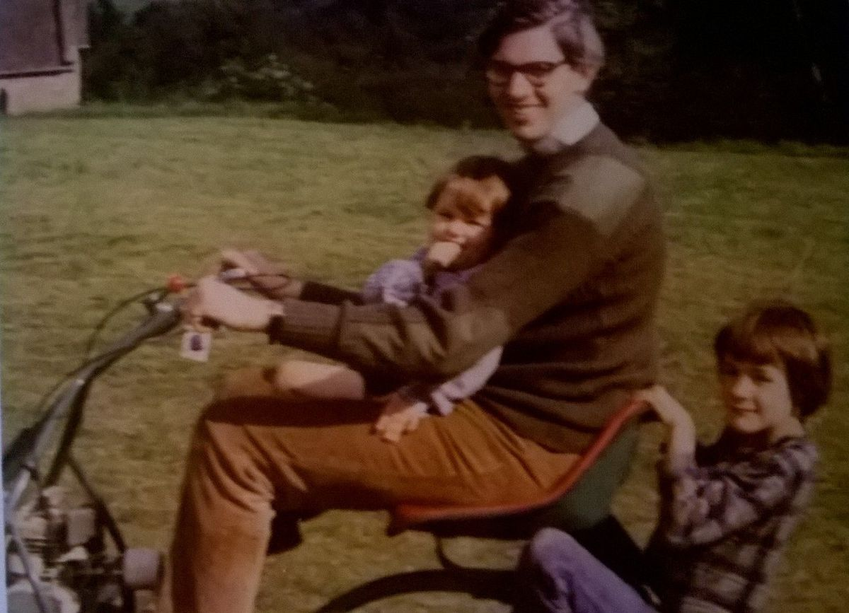 William Cash Jr, right, and his younger brother Sam, get a ride on the lawn mower with their father Bill in the 1970s