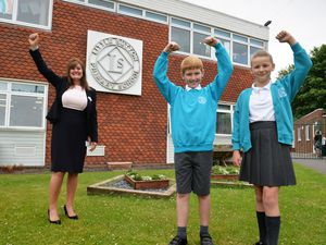 Celebrating the schools achievements, headteacher Rachel Davis MBE, with pupils Dominic Carr, aged 10, and Lily Stokes, aged 10, at Little Sutton Primary School, Sutton Coldfield