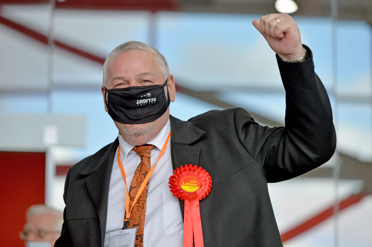 Council leader Ian Brookfield celebrates after winning Bushbury South and Low Hill