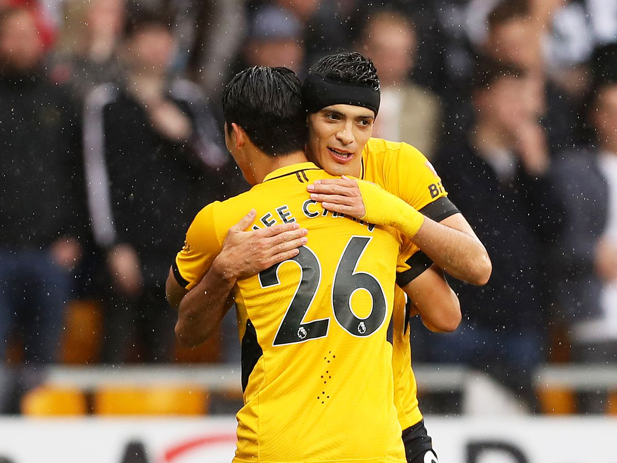 WOLVERHAMPTON, ENGLAND - OCTOBER 02: Hee-chan Hwang of Wolverhampton Wanderers celebrates scoring his team's first goal with Raul Jimenez during the Premier League match between Wolverhampton Wanderers and Newcastle United at Molineux on October 02, 2021 in Wolverhampton, England. (Photo by Jack Thomas - WWFC/Wolves via Getty Images).